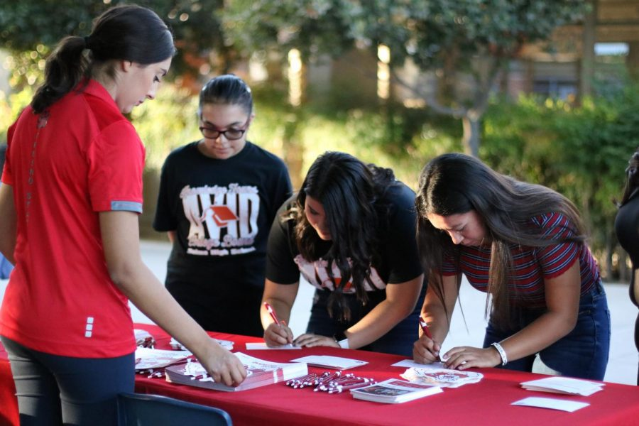 Students receive information from a Fresno State representative.