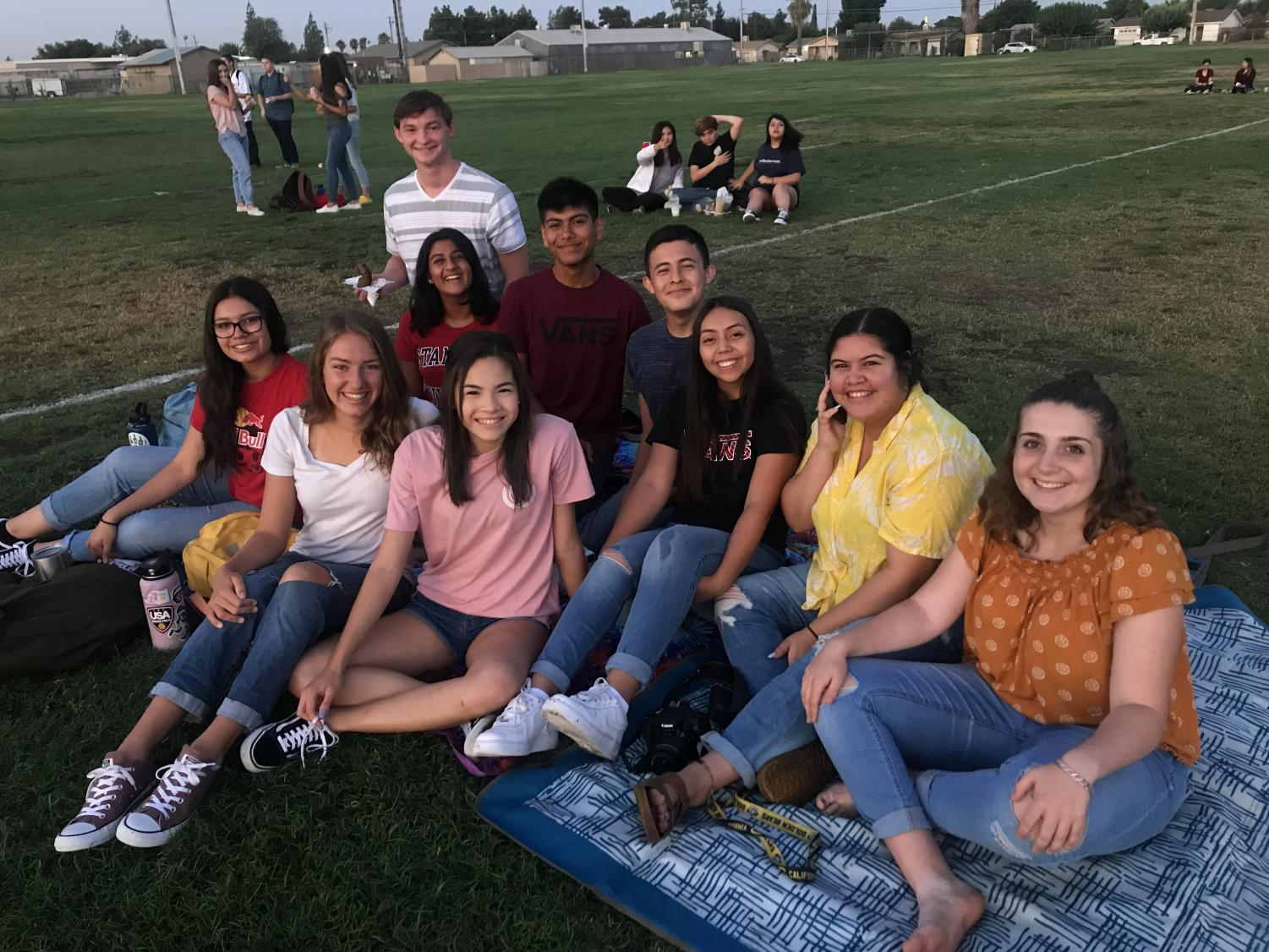Seniors gather together for Senior Sunrise on the softball practice field. Photo contributed by Noelle Marroquin