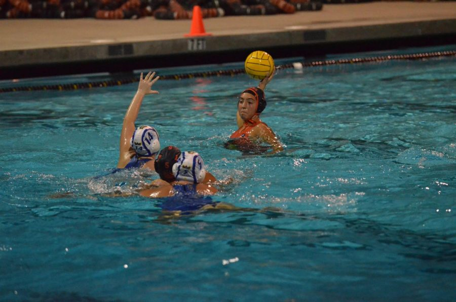Varsity junior Julianna Colado in action as she shoots a goal. Photo by Victoria Quintana