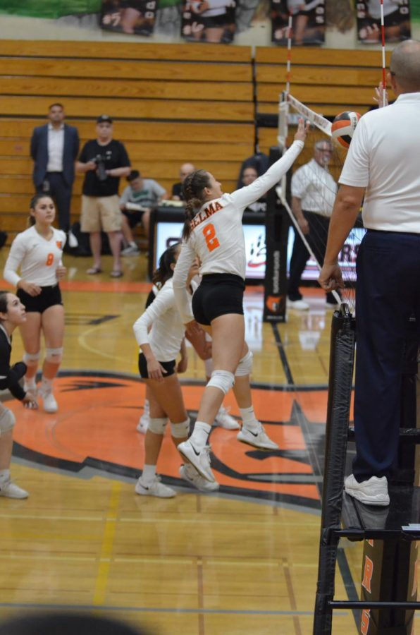 Marissa Cerda in action as she blocks a hit. Photo by Katarina Quintana