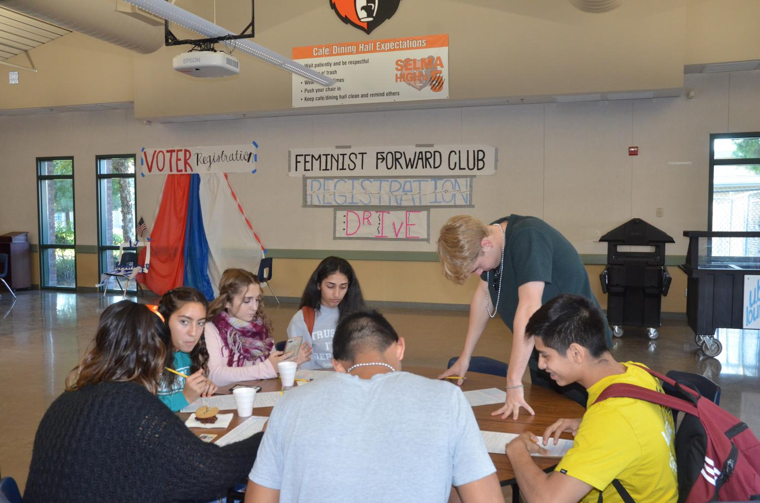 The Feminist Forward Club helps students register to vote.