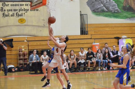 Clarissa Moreno goes for the layup.  Photo by Julianna Colado