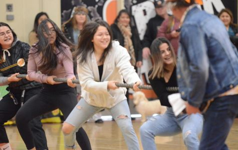 Girls wrestling takes the win in tug-of-war against boys wrestling. Photo by Mia Salinas