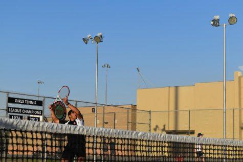 Senior Simran Bains gets ready to smash the ball. Photo by Dashrit Pandher