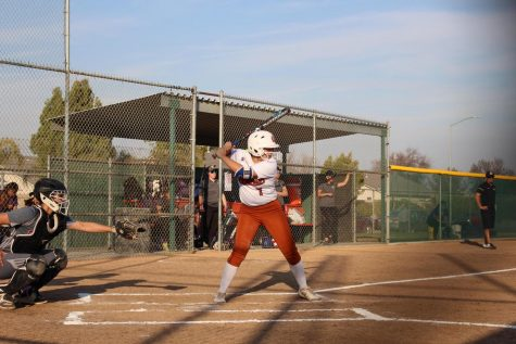 Genna Martinez winds up to hit the ball.