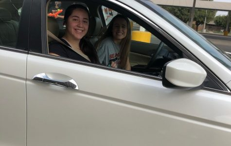 Seniors Lilliana Garcia and Sarah Mitchell participate in Selma High's 1st annual Car Parade Donation Collection. Photo by Chloe Mendoza