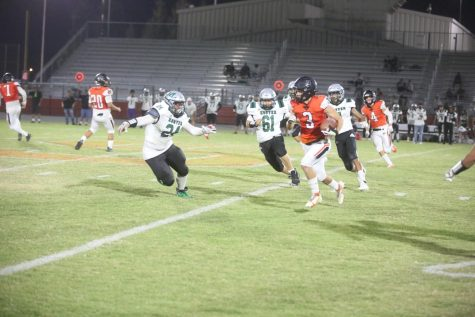 Number 3, Dominic Gonzales, running to the end zone.
