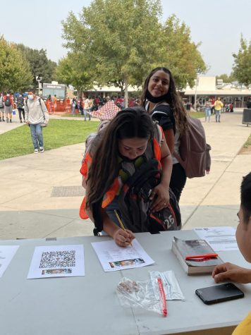 Chantel Rodriguez and Alyssa Vasquez sign up for Book Club